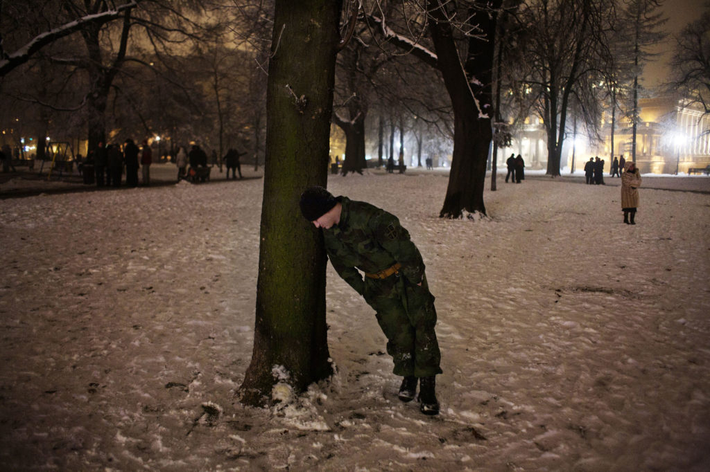 A drunk Serbian soldier during New Year's Eve celebrations in Belgrade. January 2011.
